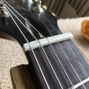 guitar nut, electric guitar setup, truss rod adjustment